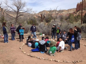 Children help build a Medicine Water Wheel at Ghost Ranch
